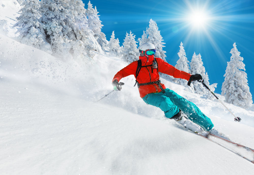 skier in deep snow on a sunny day